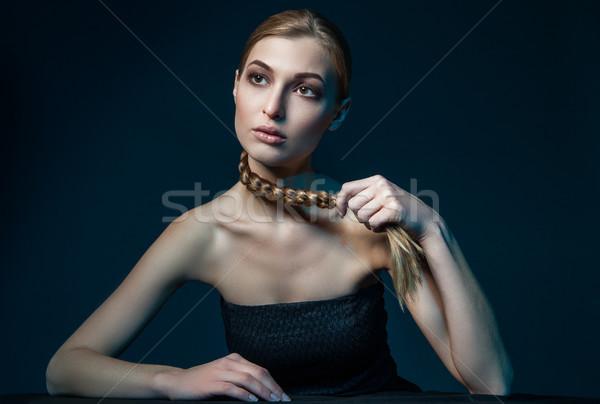 Woman holding braid Stock photo © julenochek