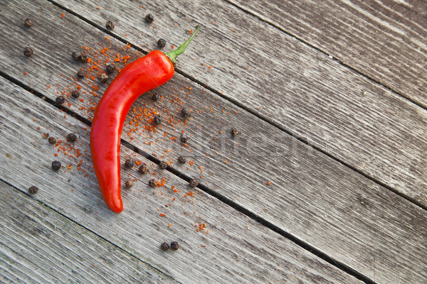 Red hot chili peppers on wood Stock photo © julenochek