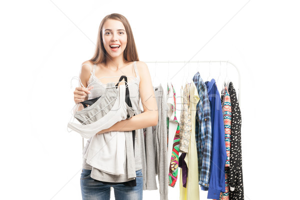 Stock photo: Happy woman holding several tops