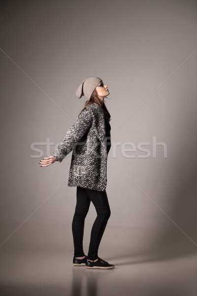 Fashion model woman posing wearing hat and black coat Stock photo © julenochek