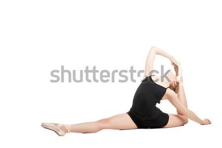Blonde woman in split bending back Stock photo © julenochek