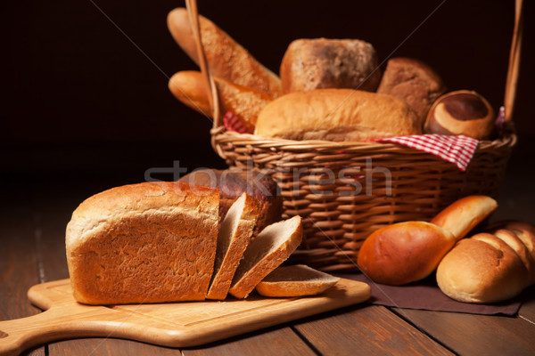 Composition with bread and rolls in wicker basket Stock photo © julenochek