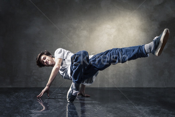 urban hip hop dancer over grunge concrete wall Stock photo © julenochek