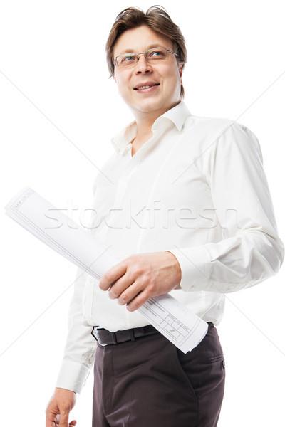 Contractor wearing suit holding blueprints Stock photo © julenochek