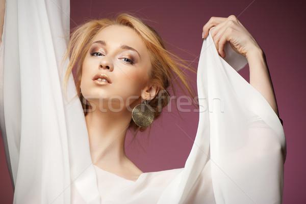 Beautiful woman with arms draped in white chiffon  Stock photo © julenochek
