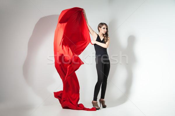 Lány tart piros ruha integet fiatal lány Stock fotó © julenochek