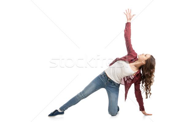Fiatal lány tánc fehér fiatal főiskolás lány hallgat Stock fotó © julenochek