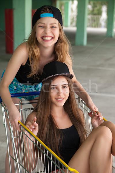 Lányok bevásárlókocsi néz kamera portré gyönyörű Stock fotó © julenochek