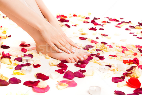 Homme tendre mains pieds Photo stock © julenochek
