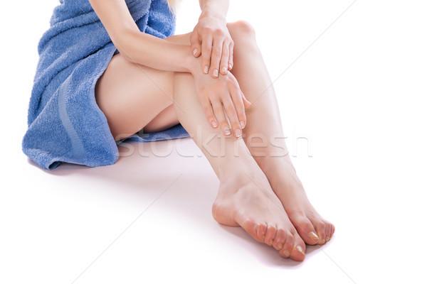 Woman in towel sitting on floor, stroking her legs Stock photo © julenochek
