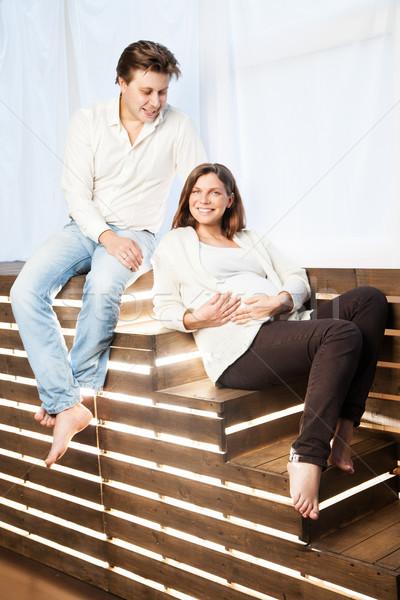 Pár otthon ül lépcsősor terhesség terhes nő Stock fotó © julenochek