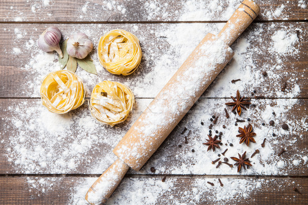 Wooden rolling pin with flour and pasta Stock photo © julenochek