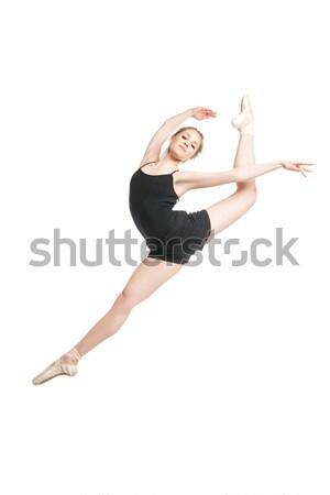 Elegant ballet dancer in mid air split Stock photo © julenochek
