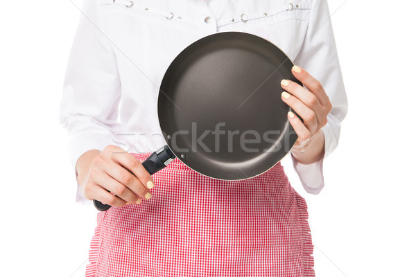 Woman holding frying pan Stock photo © julenochek