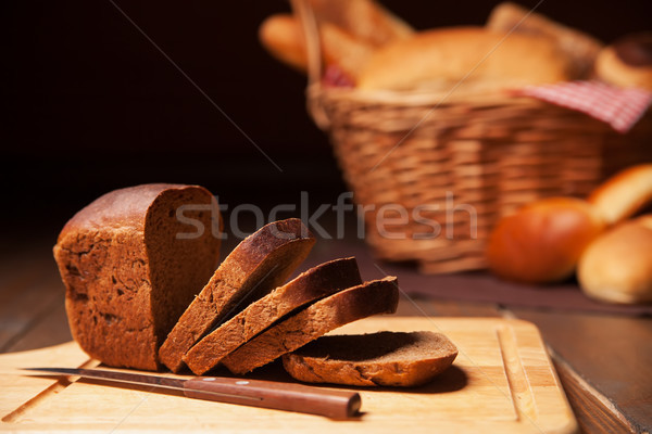 Sliced rye bread and basket  Stock photo © julenochek