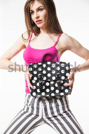 Smiling brunette hugging polka dot fashion bag Stock photo © julenochek