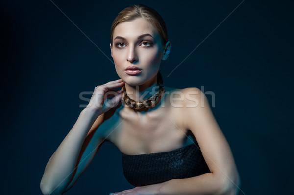 Stock photo: Woman with plait around neck