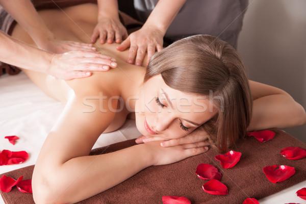 Young woman having massage in beauty spa. Stock photo © julenochek