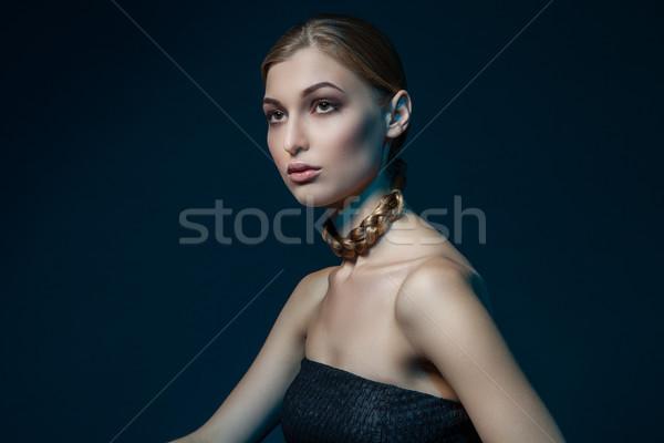 Woman with plait around neck Stock photo © julenochek
