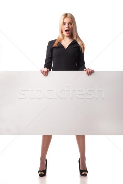 Meglepődött üzletasszony tart plakát izolált fehér Stock fotó © julenochek