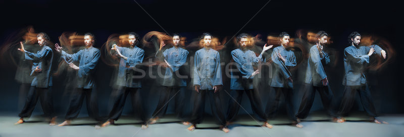 Man in kimono excercising Martial Arts Stock photo © julenochek