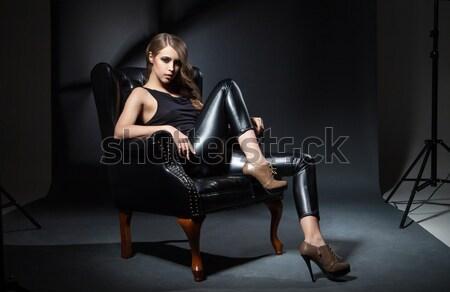 sexy woman in black dress and jalousie Stock photo © julenochek