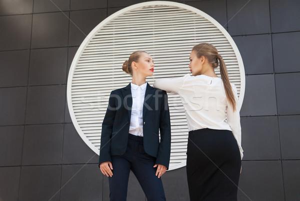 два женщины позируют здании стены Сток-фото © julenochek