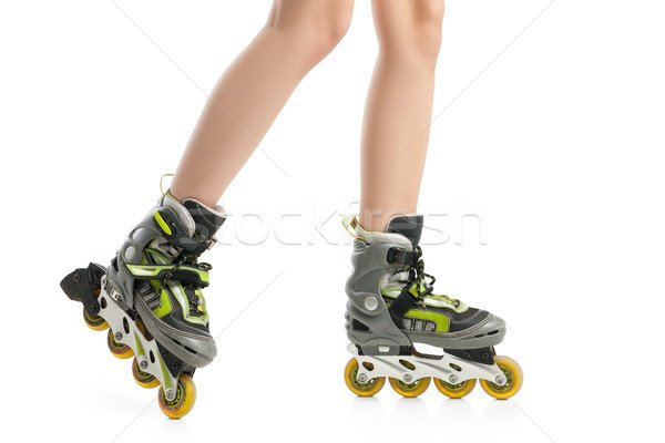 Close up  picture of woman's legs with rollerskates  Stock photo © julenochek
