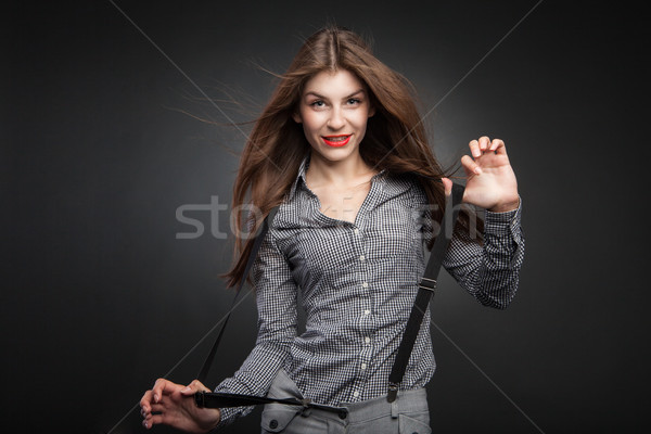Happy woman pulling suspenders. Stock photo © julenochek