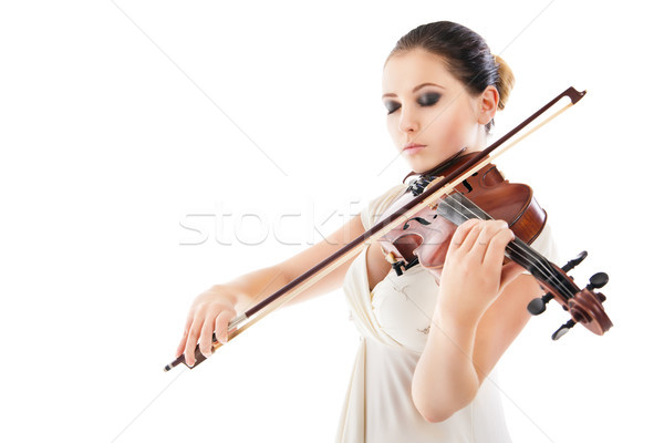 Stock photo: Beautiful young woman playing violin over white