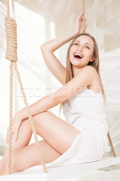 view of nice young lady swinging  in studio Stock photo © julenochek