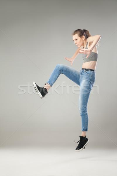 Portrait of woman jumping in studio Stock photo © julenochek