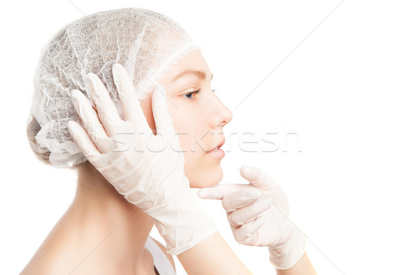 Unrecognizable person in gloves touching girl's face Stock photo © julenochek