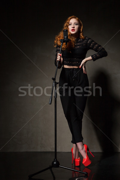 Portre güzel şarkıcı kırmızı topuk siyah Stok fotoğraf © julenochek
