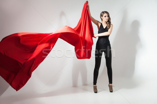 Oldalnézet fiatal nő integet piros ruha fiatal Stock fotó © julenochek