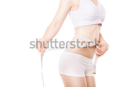 Slimming woman measuring thigh with tape Stock photo © julenochek