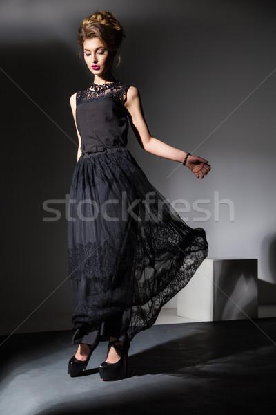 Piękna model czarna sukienka ruchu portret elegancki Zdjęcia stock © julenochek