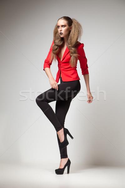 Model kırmızı ceket siyah yüksek topuklu Stok fotoğraf © julenochek