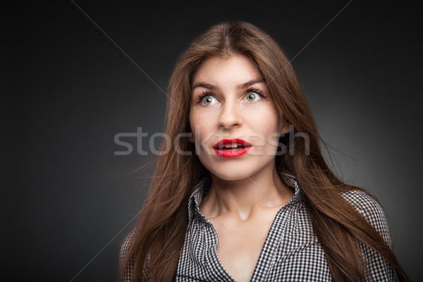 Shocked girl with wide opened eyes. Stock photo © julenochek