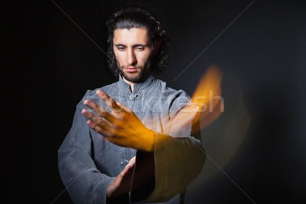 Férfi kimonó küzdősportok portré fekete tűz Stock fotó © julenochek