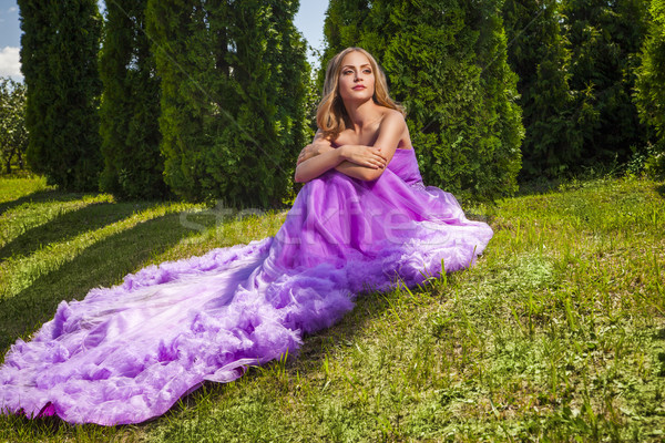 Blonde lady in pink dress with long skirt looking away Stock photo © julenochek