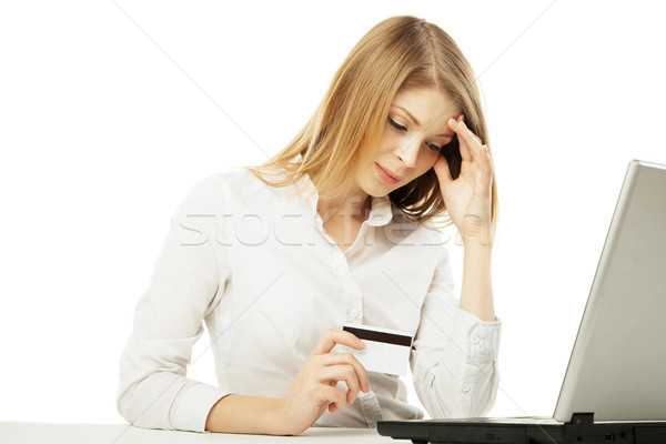 Shoked businesswoman with laptop and credit card Stock photo © julenochek