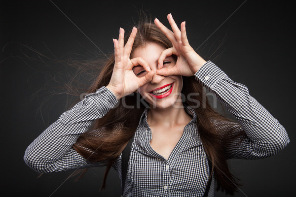 Woman making glasses out of her hands. Stock photo © julenochek