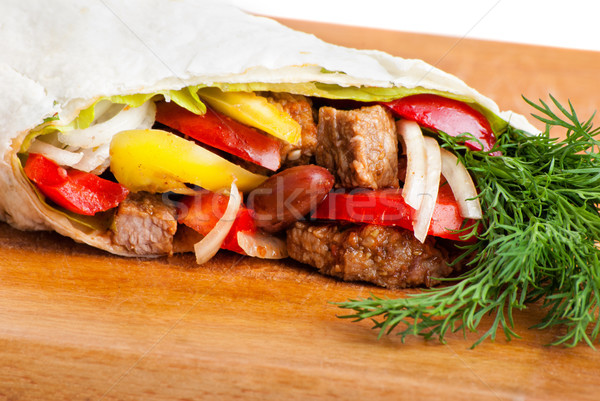 beef burrito with peppers, onion and tomato Stock photo © julenochek