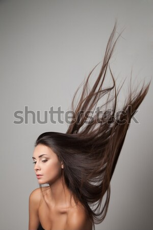 Calm young woman with  shiny hair looking away Stock photo © julenochek