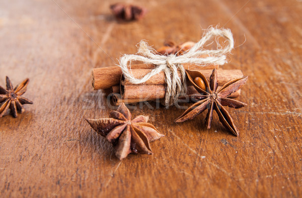 Cinnamon sticks and star anise on rustic wood Stock photo © julenochek
