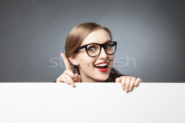 Stock photo: woman with finger up looking at camera