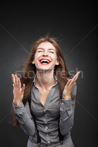 Joyful woman with flying hair and wind in her face. Stock photo © julenochek