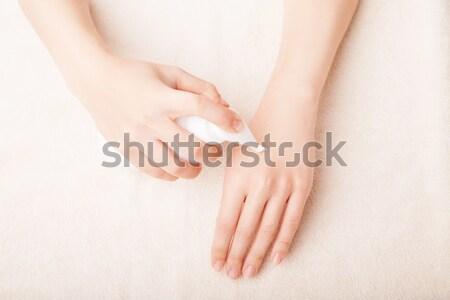 Mujer crema cuidado de la piel manicura nina Foto stock © julenochek