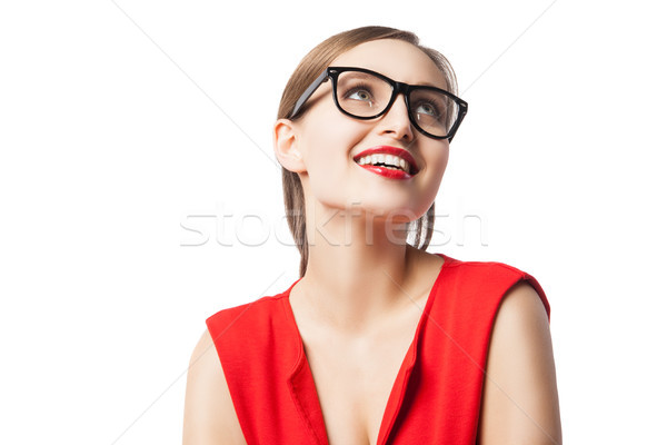 Fair-haired woman with red lips smiling while looking up Stock photo © julenochek